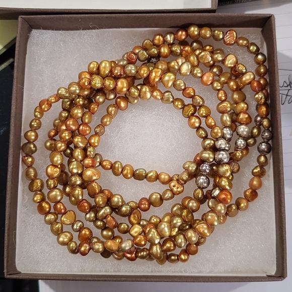 Set of 7 stretch bracelets by Silpada.